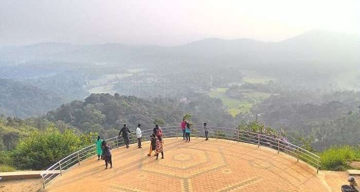tourists enjoying the view from raja's seat