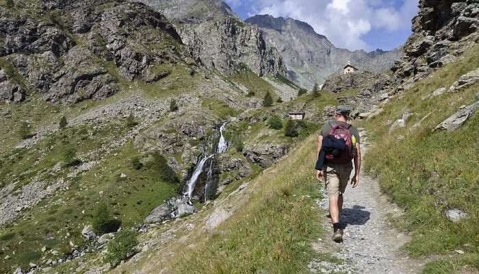 man trekking amidst mountains