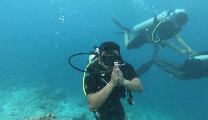 induge in scuba diving