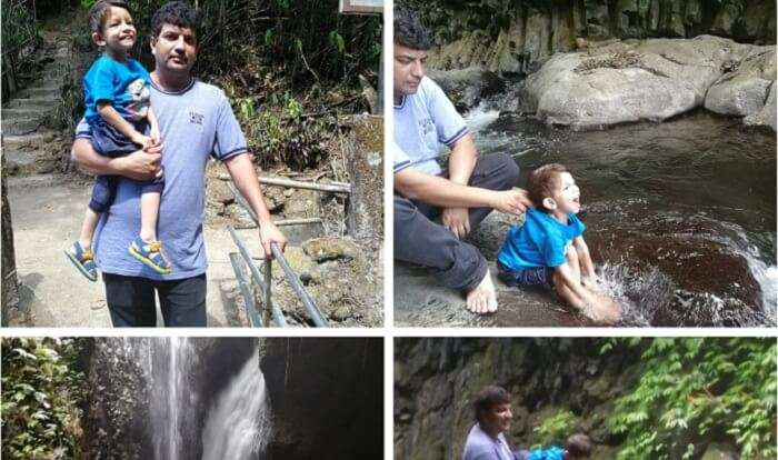 having fun with kid to waterfall side