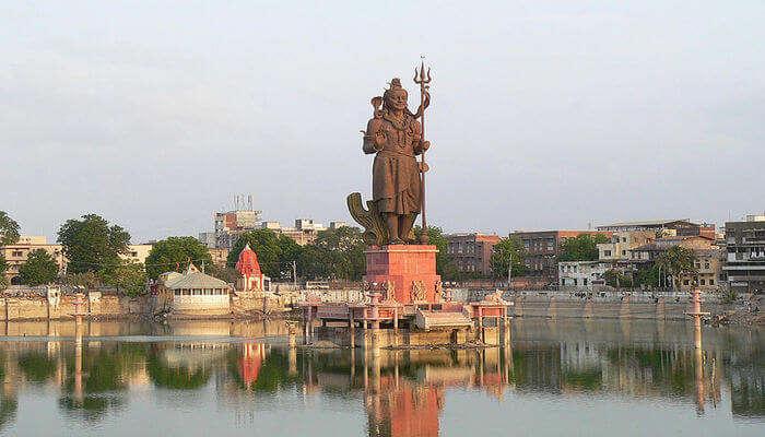 Shiva's Statue between the lake