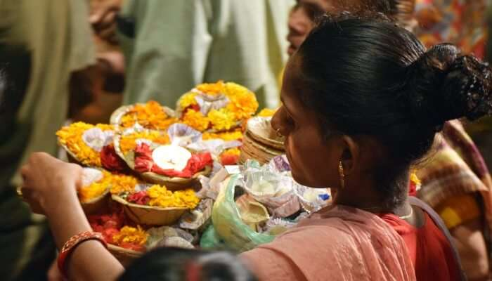 woman doing aarti