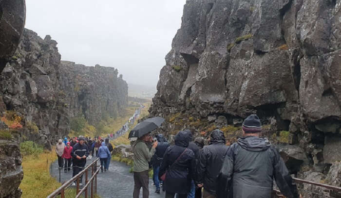 Between Eurasian and North American tectonic plates at Thingvellir National Park
