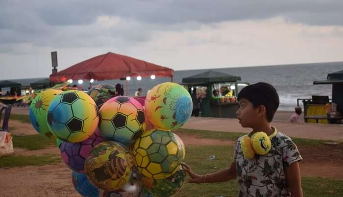 kid is enjoying with balloon