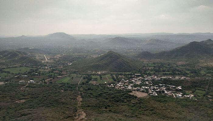 Mountains and Sajjangarh Fort