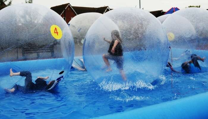 Children enjoy 'zorbing' at youth center